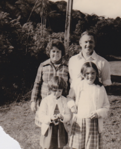 1.1 Bryan Joseph THOMAS with his family near the road of property at 36 Boylan Road, Titirangi, Auckland