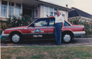1.1 Bryan Joseph THOMAS with the Taxi taken about 1981 in front of the home at 33 Belfast Street Hillsborough, Auckland