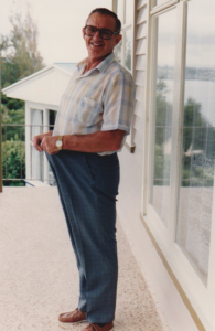 1.1 Bryan Joseph THOMAS weight loss after heart attack. Standing on the verandah of home at Hillsborough, Auckland about 1990